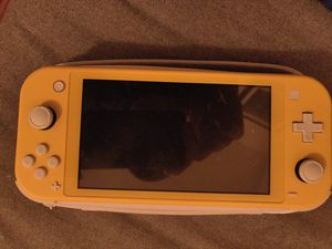 Nintendo Switch lite yellow with case for Sale in Miami, FL