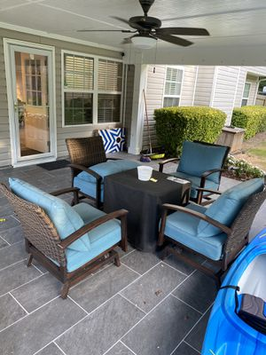 Four rocking motion wicker chairs with fire pit for Sale in Sugar Hill, GA