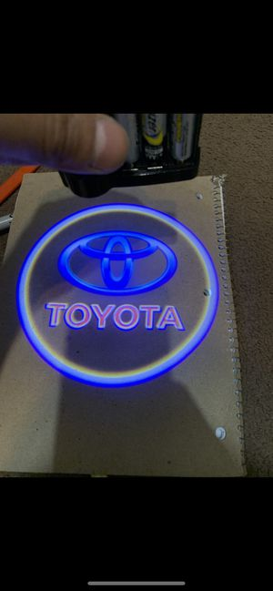 Toyota car projector shadow lights puddle light auto on/off aaa batteries for Sale in Paramount, CA