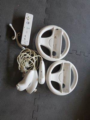 Wii controller, 2 steering wheels and 3 joy sticks for Sale in Corona, CA