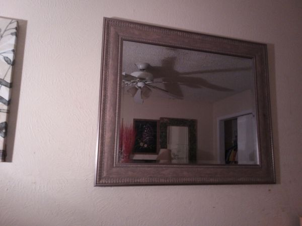 Studded wall frame mirror wit clean finish fine detailing along the sides