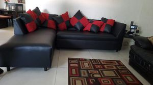 Sectional black whit pillows . Brand new for Sale in Miami, FL