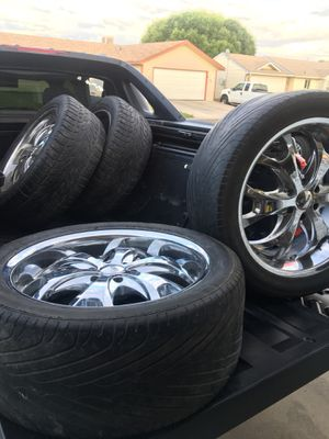 "22"" rims 2 tires 305/45r22 and the other 2 305/40r22 for Sale in Grand Junction, CO"