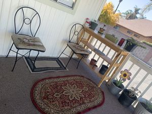 2 patio chairs iron with cushions outdoor furniture for Sale in Hemet, CA