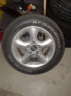2-Goodyear tires in decent condition with decent tread, on aluminum rims. P215/ 60/ R15 for Sale in Washington, IL