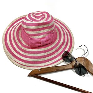 Kate Spade Women's pink striped floppy sun hat for Sale in Olympia, WA