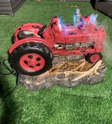 Small tractor fountain with lights and fog
