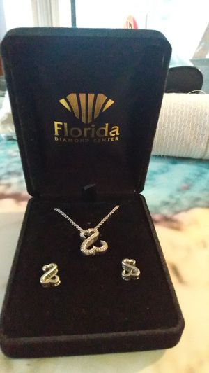 This is a open heart collection with real diamonds the earrings have diamonds on the sides sterling silver it's from Florida diamond center for Sale in Tarpon Springs, FL
