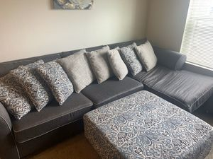 Bobs furniture sectional couch and ottoman with pillows. for Sale in Raleigh, NC