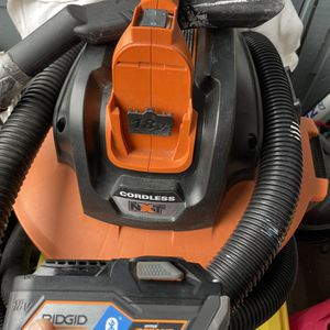 PERFECT CONDITION RIGID WET DRY VACCUM W/DUAL 18V BATTERY AND ADDITIONAL EXTRA HOSE ONLY HAVE 1-18VOLT BATTERY BLUETOOTH INCLUDED No Charger ONLY80$ for Sale in Haltom City, TX