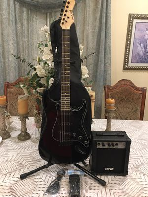 Electric guitar package with amplifier soft case strap cable and pick for Sale in Cudahy, CA