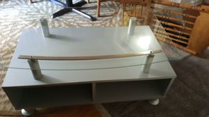 A gray and glass TV stand for Sale in Covington, GA