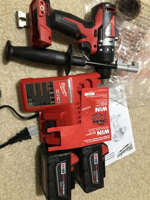 Milwaukee hammer dill 2 batterys 5.0ah and charger brand new for Sale in Tacoma, WA