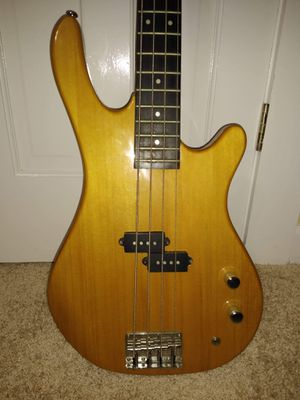Samick bass guitar with backpack style carrying case for Sale in Kannapolis, NC