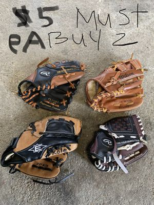 Baseball glove $5, $15$20 and more plus bats !!! Prices on picture for Sale in Elmont, NY