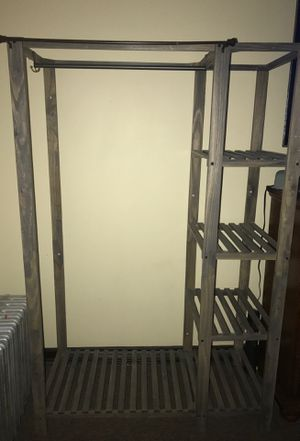 Closet organizer clothing hanging with side shelves Organizer measurements are 44 x68x20 for Sale in The Bronx, NY
