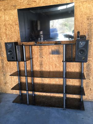 5 FT TALL USED TV STAND PLUS SPEAKERS FOR SALE! for Sale in Lawrenceville, GA