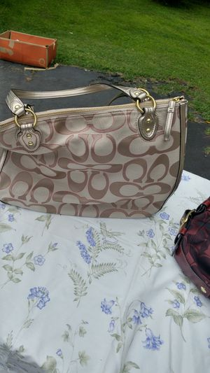 COACH MONOGRAM HANDBAG KHAKI BBACKGROUNDDARK BROWN C'S. ACCENTED IN RED TRIM GENTLY USED for Sale in Fork Union, VA