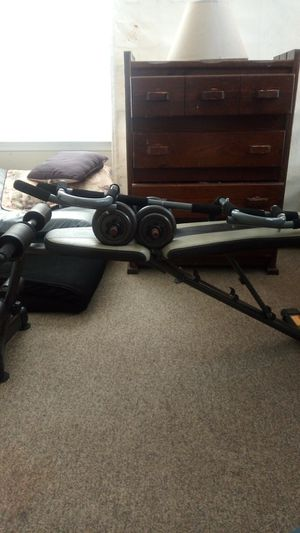 Workout bench pull up bars and weights for Sale in Glen Burnie, MD
