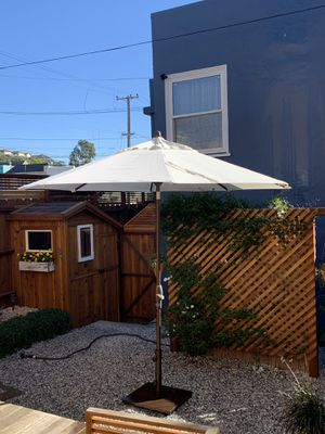 9' umbrella, with 90 lbs. solid base on wheels. Bought it from Toms outdoor furnitures earlier this year. Clean and almost like brand new! for Sale in San Francisco, CA