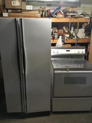 White side-by-side refrigerator with ice maker indoor, With glass top electric stove for Sale in Denver, CO