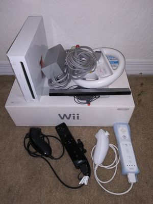 NINTENDO Wii WITH THE BOX GAMES AND ACCESSORIES for Sale in Hialeah Gardens, FL
