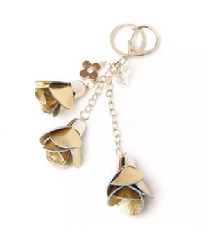 GOLD LEATHER FLORAL KEYCHAIN BACKPACK PURSE TAG for Sale in Macomb, MI