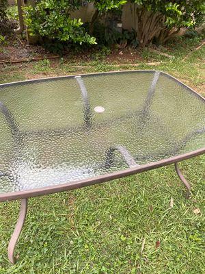 A glass outside table for Sale in Marietta, GA