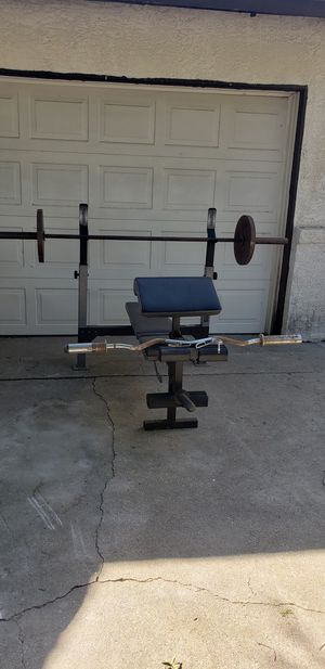 Olympic weight bench, 7ft bar, curl bar and 35lb weights for Sale in San Bernardino, CA