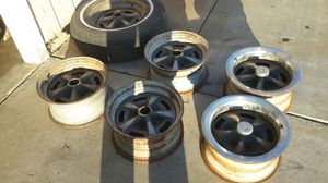PONTIAC GTO LEMANS RALLY WHEELS 14 INCH STOCK OEM ONE IS A 15 INCH ALL FOR SALE for Sale in Gustine, CA