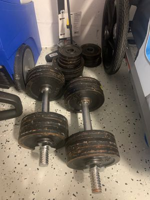 Weights with plates for Sale in Zephyrhills, FL