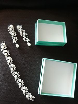 Sliver pearl and diamond earrings with matching bracelet for Sale in Phoenix, AZ