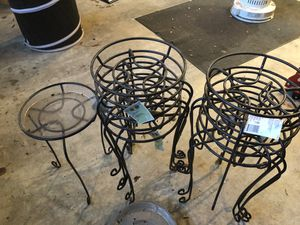 9 Metal planter stands 23 in high w plastic drip trays for Sale in Brandywine, MD