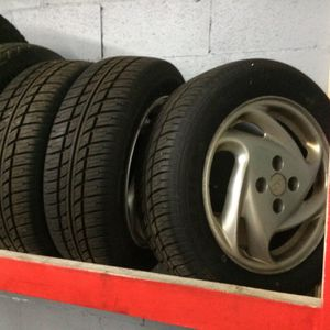 4 tires with their rims. for Sale in Flint, MI