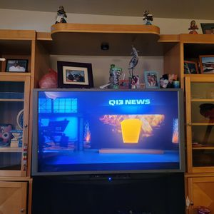 55 inch TV with Entertainment center for Sale in Renton, WA