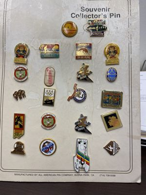 Misc Souvenir Pins on board display for Sale in Mission Viejo, CA