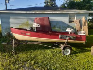 12 ft Jon boat for sale. 9.9 Chrysler Outboard Motor raised deck for platform fishing Live Well dual bilge pumps tires are like new .make offer for Sale in Lowell, IN