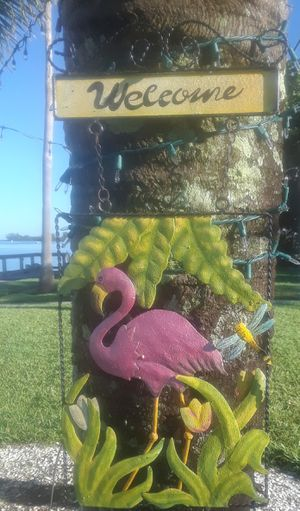 "22x10"" metal Flamingo with butterfly welcome sign for Sale in Ruskin, FL"