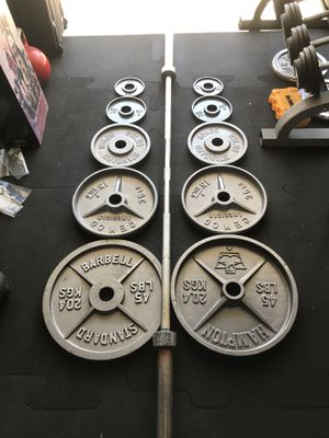 Olympic weights (2x45s 2x35s 2x25s 2x5s 2x2.5s) & 7Ft-45Lb Olympic barbell for $180 Firm!!! for Sale in Burbank, CA