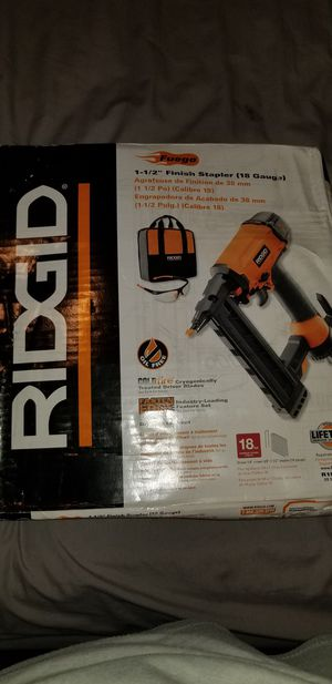 Nail gun Ridgid. Good condition, never used, still in the box, comes with safety glasses & a bag. for Sale in Houston, TX