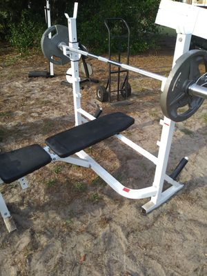 Hibetts weight bench w/weights.bar for Sale in Tampa, FL