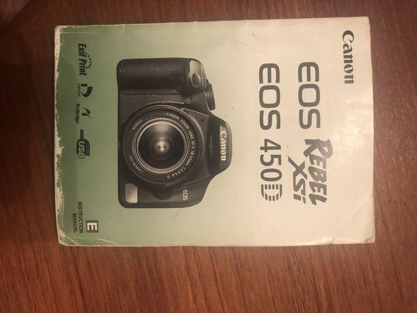Canon EPS Rebel XSI (450D) digital camera with two extra lenses and camera bag