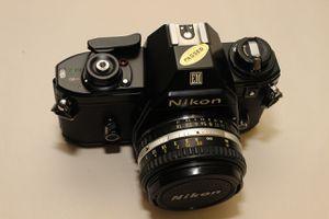 Nikon EM 35 MM Vintage film SLR camera 50 MM Lens & pouch/case for Sale in Sully Station, VA