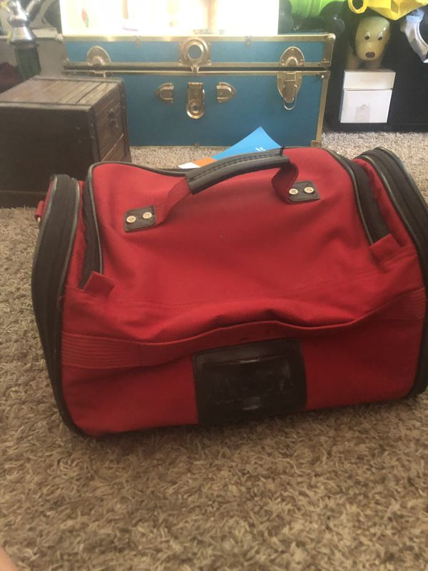 Olympia expanding red duffle bag