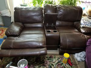 Leather double recliner with console. Very comfortable. Showing some wear but sturdy and fully functioning. No tears or holes. for Sale in Tacoma, WA