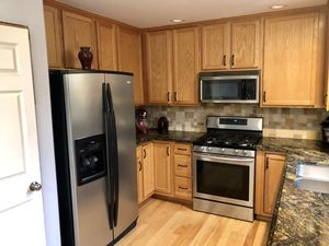 Kitchen cabinets with marble countertop and marble table for Sale in Everett, WA