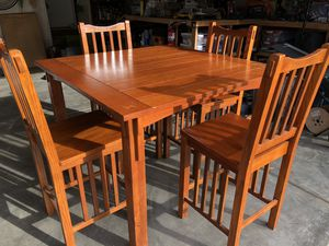 Solid wood dining pub height table with 4 chairs for Sale in Arlington, WA