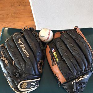 2 Baseball Gloves With Baseball for Sale in Orlando, FL