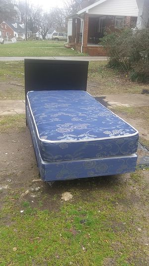 Very. Nice twin size bed complete. Headboard, metal frame a mattress and box spring. Very good condition! No stains! for Sale in High Point, NC