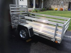 Aluma utility trailer 54 inches x 8 ft long with hand winch and new tires. for Sale in Dayton, MN